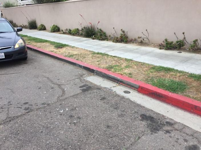 """An illegally painted red curb in La Jolla Shores. Last weekend, city crews painted over 154 feet of such curbs after receiving complaints. <span class=""""copyright"""">(San Diego Union-Tribune)</span>"""