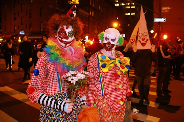 <p>Gruesome killer clowns are seen in the 44th annual Village Halloween Parade in New York City on Oct. 31, 2017. (Photo: Gordon Donovan/Yahoo News) </p>