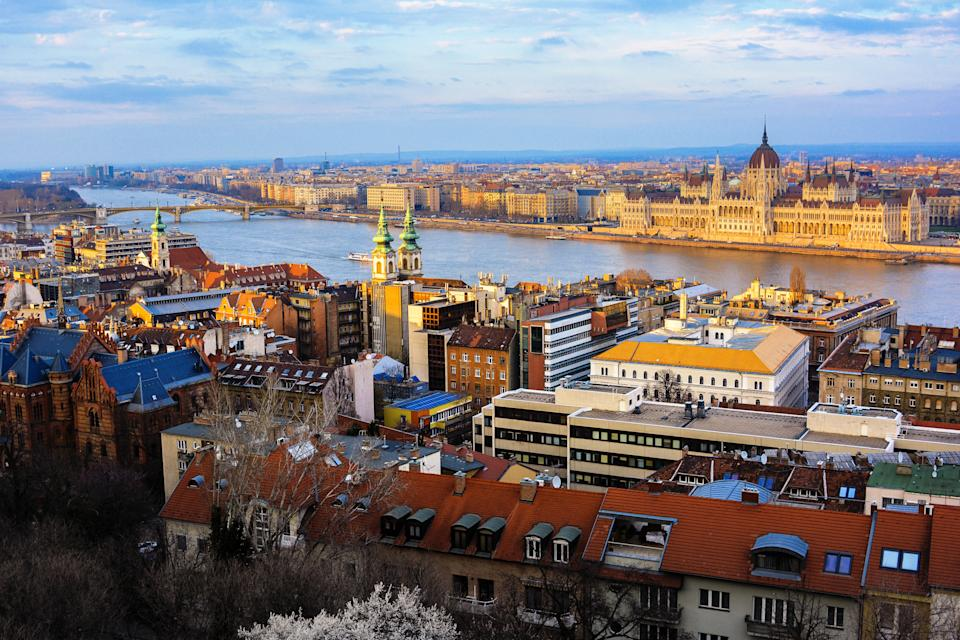 Panoramic view of Budapest, Danube river and Hungarian parliament with dynamic sky at sunset