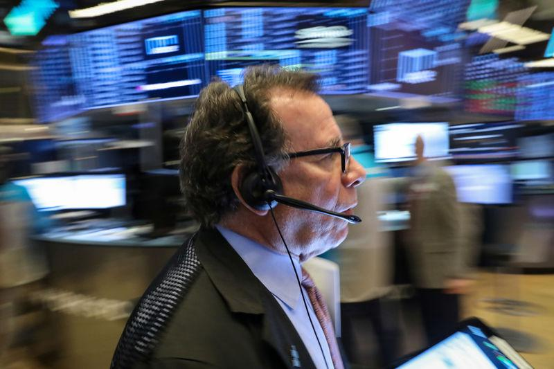 Trader works on the floor of the NYSE in New York