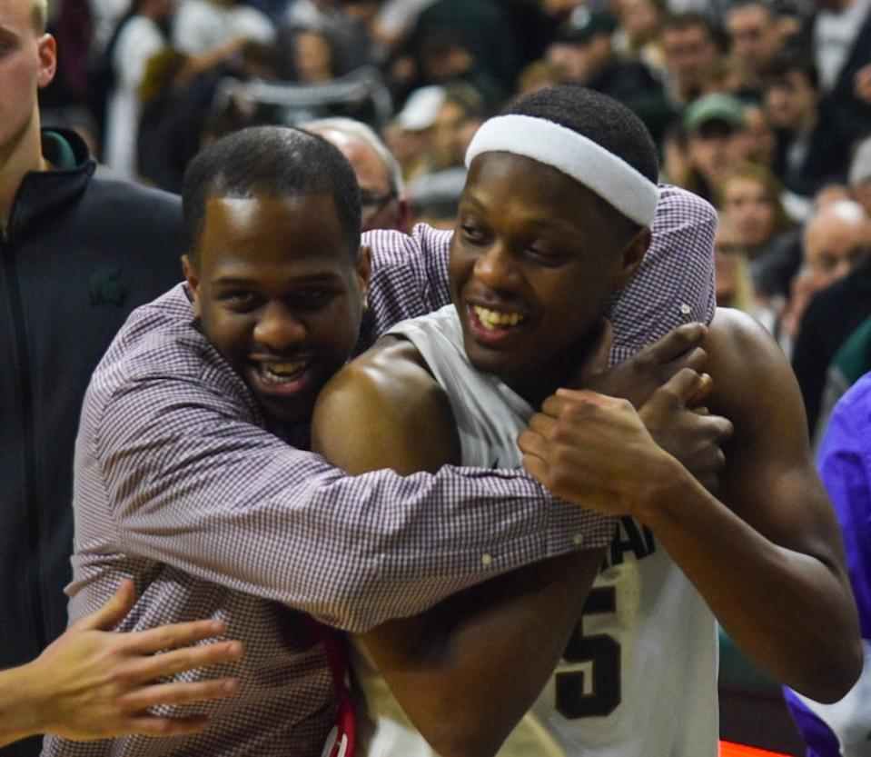 Zachary Winston embraces his brother Cassius during the Albion vs. MSU exhibition game, Tuesday, Oct. 29, 2019. Zachary, who was 19 years old, died a little over a week later.