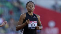 Allyson Felix competes in the first semi final of the women's 400-meter run at the U.S. Olympic Track and Field Trials Saturday, June 19, 2021, in Eugene, Ore. (AP Photo/Ashley Landis)