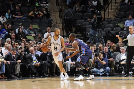 SAN ANTONIO, TX - JANUARY 30: Tony Parker #9 of the San Antonio Spurs looks to pass the ball against Kemba Walker #15 of the Charlotte Bobcats on January 30, 2013 at the AT&T Center in San Antonio, Texas