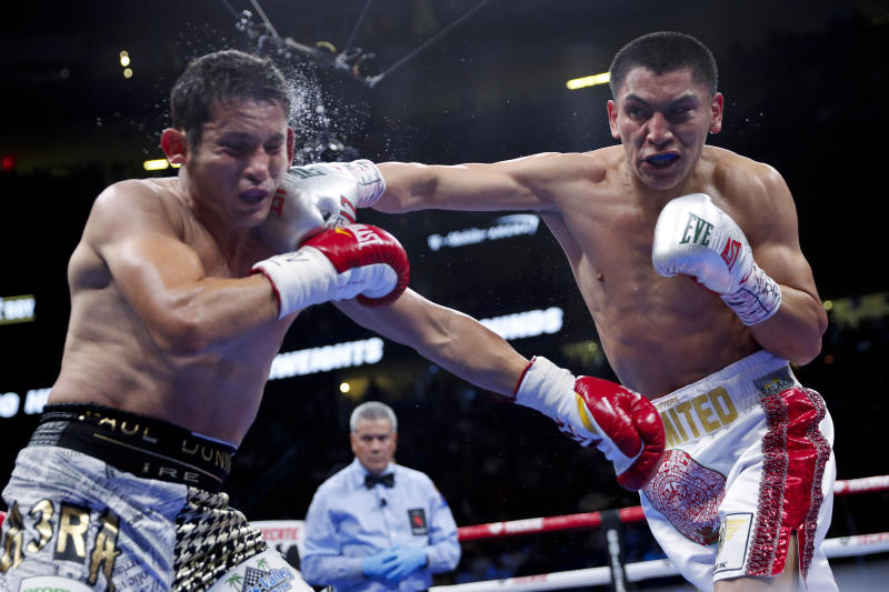 Vergil Ortiz Jr., right, hits Mauricio Herrera during a welterweight boxing match Saturday, May 4, 2019, in Las Vegas. (AP Photo/John Locher)