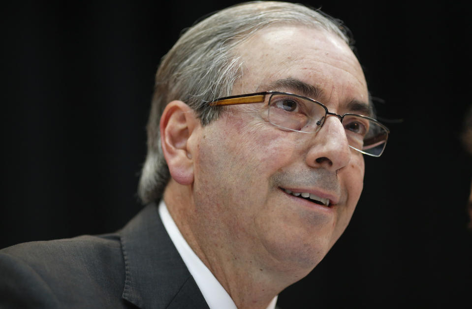 Eduardo Cunha, president of Brazil's Chamber of Deputies, smiles during a union workers' meeting in Sao Paulo, Brazil, Friday, Aug. 21, 2015. Brazil's attorney general filed corruption charges Thursday against the speaker of the lower house of congress for his alleged involvement in a massive corruption scandal at the country's state-run oil company Petrobras. (AP Photo/Andre Penner)