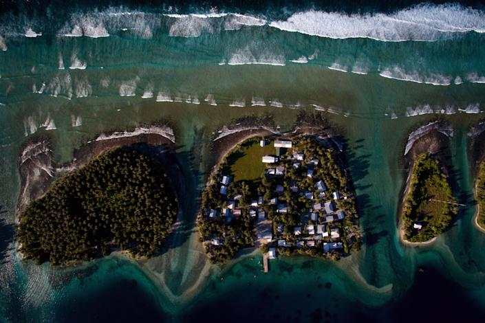 Homes on Ejit, an islet in the Majuro Atoll, Marshall Islands, pictured on Oct. 29, 2015, are under threat from rising seas.  (Josh Haner/The New York Times)