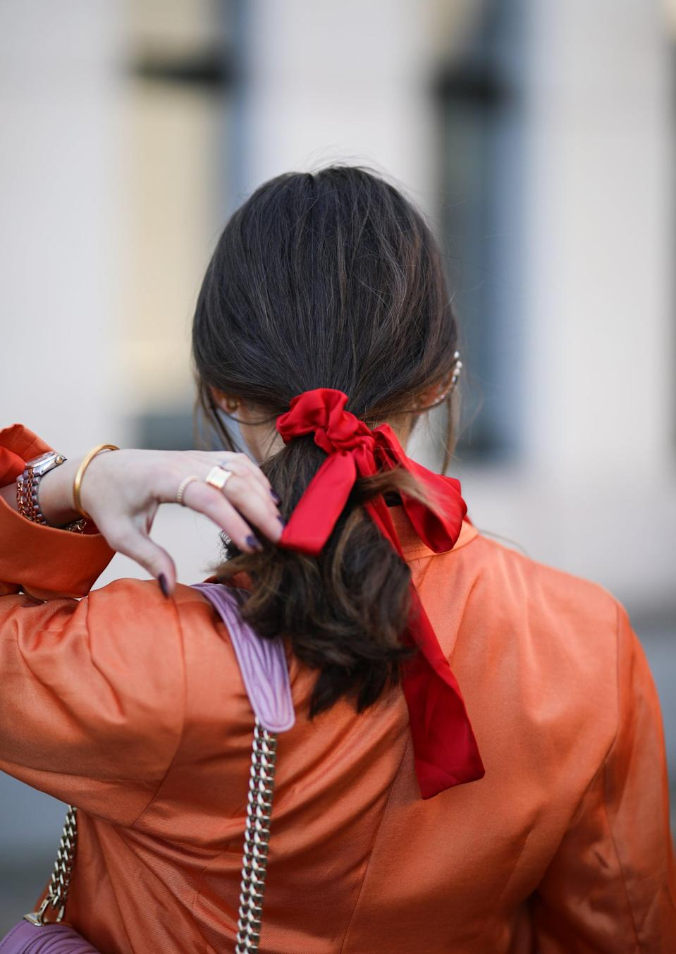 """<p>No idea how to braid? Consider your other options: """"When hair is in a secure ponytail, it's easy to spice up the style by adding a couple of well-placed, bedazzled snap clips, bobby pins, or barrettes. You can even add a statement scrunchy at the base of the tail.""""</p>"""