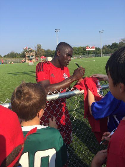 Buba Jobe signs autographs after practice. (Courtesy of Gemmell family)