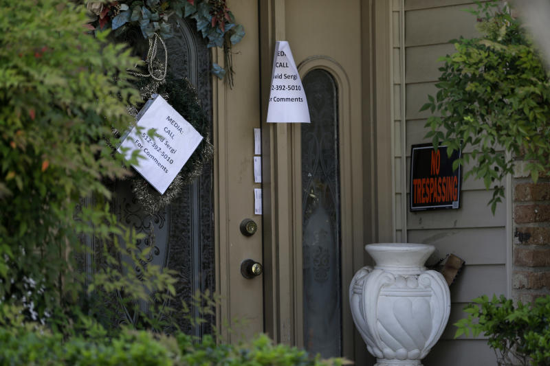 File - In this April 15, 2013 file photo, a printed sign on the door of the home of Eric Lyle Williams directs media to a spokesperson for the Williams family in Kaufman, Texas. Texas authorities have arrested the former justice of the peace's wife, Kim Lene Williams. Online jail records do not list charges against her and officials in Kaufman County wouldn't immediately comment on the reason for her arrest. A law enforcement official has said authorities are trying to build a case against Eric Lyle Williams in the deaths of Kaufman County District Attorney Mike McLelland and his wife, Cynthia. (AP Photo/Tony Gutierrez, File)