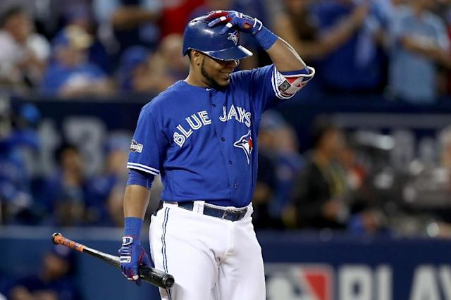 Edwin Encarnacion of the Toronto Blue Jays reacts in the ninth inning against the Cleveland Indians during game five of the American League Championship Series (AFP Photo/Elsa)