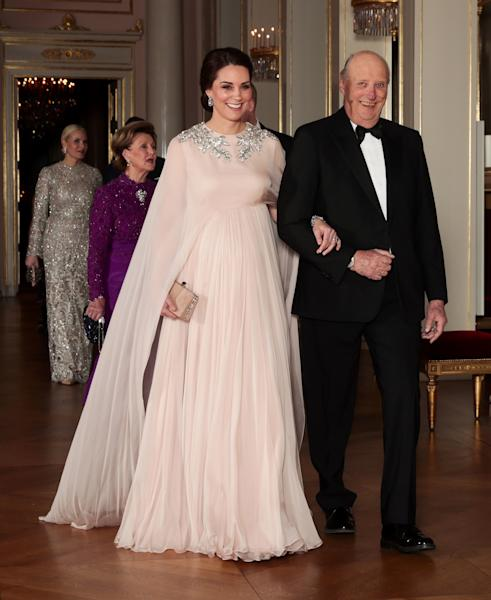 "<div class=""caption""> Who: Catherine, Duchess of Cambridge <br> What: Alexander McQueen<br> Where: At a dinner at the Royal Palace, Oslo, Norway<br> When: February 1, 2018<br><br><br> </div> <cite class=""credit"">Photo: Getty Images</cite>"