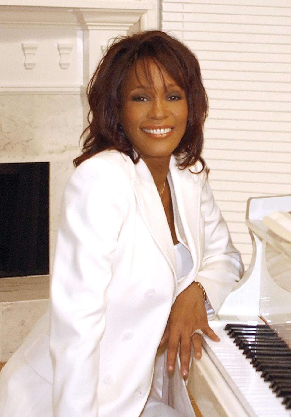 Whitney Houston, who grew up singing at her local church and kept religion as a focal point in her life, left behind a Bible in one her homes, and it's now on sale for close to $100,000. (Photo: Getty Images)