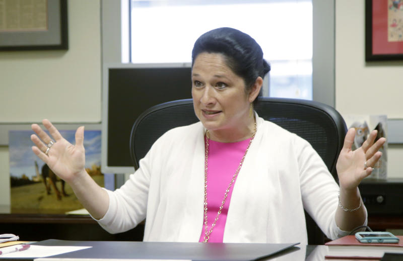 FILE - In this June 14, 2017, file photo, Illinois Comptroller Susana Mendoza, speaks during an interview in Chicago. A review of Illinois' $16 billion pile of overdue bills by Mendoza shows that likely half haven't been submitted for processing, and there's no way of knowing whether there's even authority to pay. (AP Photo/G-Jun Yam File)