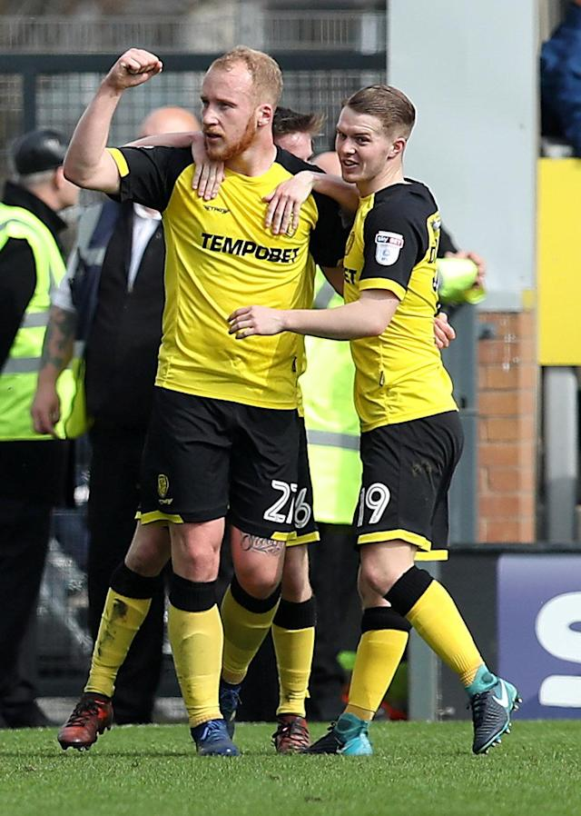 "Soccer Football - Championship - Burton Albion vs Derby County - Pirelli Stadium, Burton-on-Trent, Britain - April 14, 2018 Burton Albion's Liam Boyce celebrates with team mates after scoring their first goal Action Images/John Clifton EDITORIAL USE ONLY. No use with unauthorized audio, video, data, fixture lists, club/league logos or ""live"" services. Online in-match use limited to 75 images, no video emulation. No use in betting, games or single club/league/player publications. Please contact your account representative for further details."