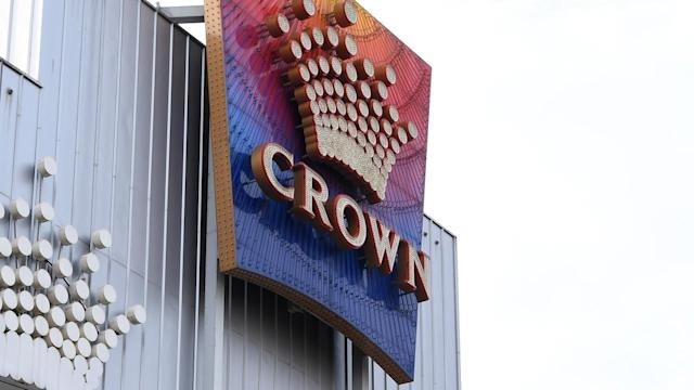 Crown Casino has implemented social distancing on the gaming floor ban banned large gatherings