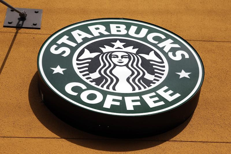 FILE - This Jan. 3, 2012 file photo shows the Starbucks Coffee logo in Mountain View, Calif. Starbucks Corp. is pushing beyond coffee with the opening of its first Evolution Fresh Inc. juice store, the company said Monday, March 19, 2012. ( AP Photo/Paul Sakuma, File)