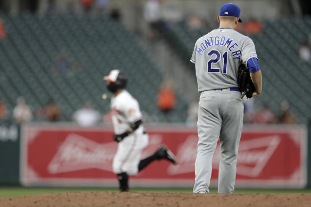 Kansas City Royals starting pitcher Mike Montgomery (21) walks near the mound after allowing a two-run home run to Baltimore Orioles' Jonathan Villar, back, during the second inning of a baseball game, Wednesday, Aug. 21, 2019, in Baltimore. (AP Photo/Julio Cortez)