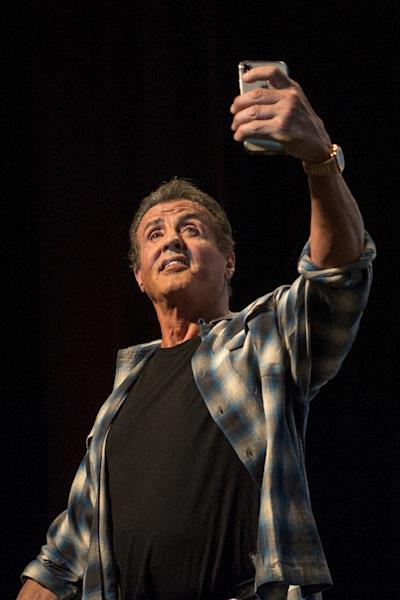 Sylvester Stallone films the standing ovation he got from cinema lovers at the Cannes film festival (AFP Photo/LOIC VENANCE)