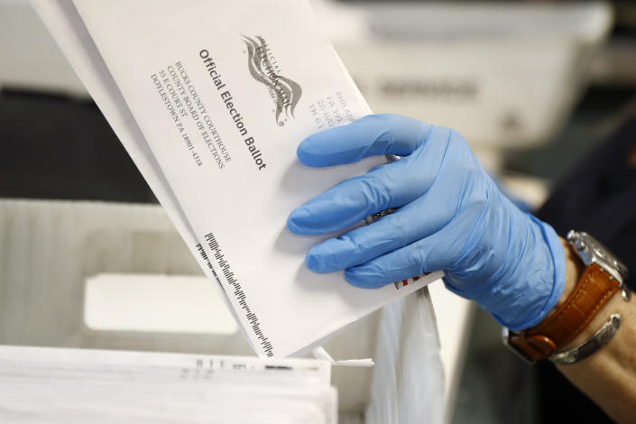 A worker processes mail-in ballots at the Bucks County Board of Elections office prior to the primary election on May 27, 2020 in Doylestown, Pa. (Matt Slocum/AP)