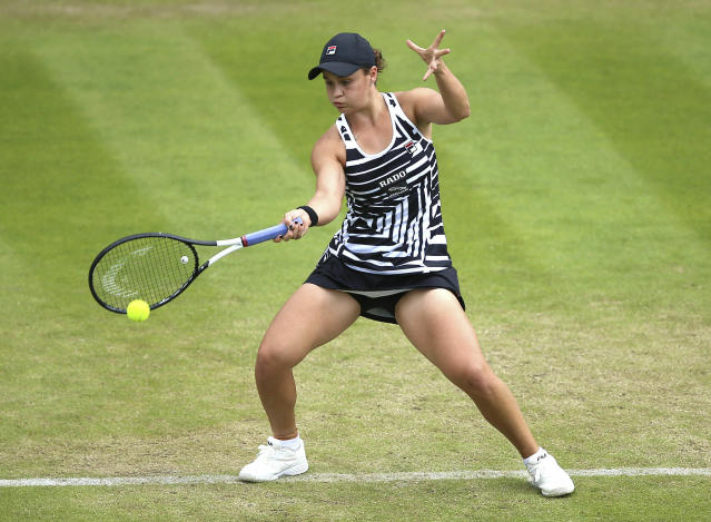 Australia's Ashleigh Barty returns to Venus Williams of the U.S during day seven of the Nature Valley Classic at Edgbaston Priory Club, Birmingham, England, Friday, June 21, 2019. (Nigel French/PA via AP)