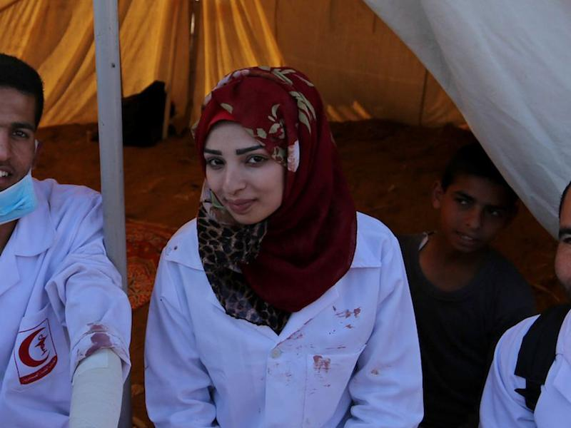 Najjar was often photographed on the front line with the blood of her patients spattered on her white medic's uniform: Rex
