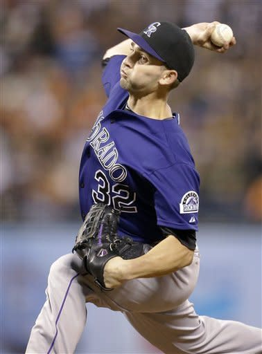 Colorado Rockies pitcher Tyler Chatwood throws to a San Francisco Giants batter during the first inning of a baseball game in San Francisco, Friday, Aug. 10, 2012. (AP Photo/Tony Avelar)