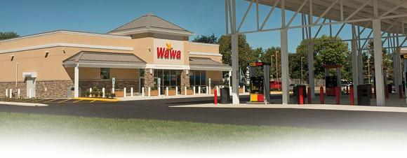 A Wawa store with gas pumps in the foreground