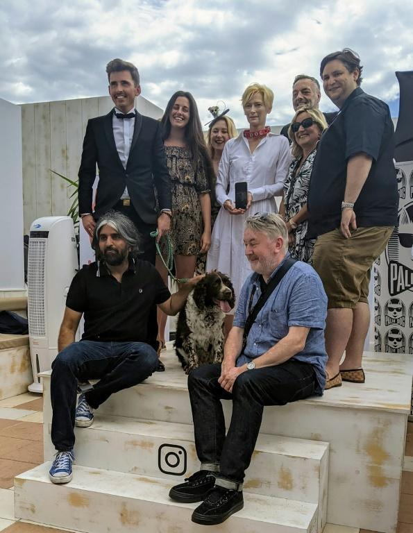 We doggone won: Tilda Swinton (C) sporting the Palm Dog collar after her dogs won the prize for the best canine performance at the Cannes film festival