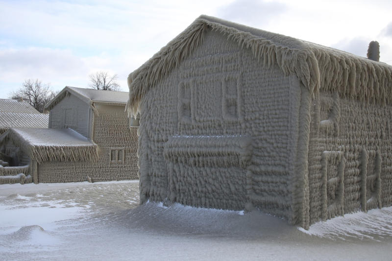 Houses along Hoover Beach is covered by ice from high winds and from the waves from Lake Erie, Saturday, Feb. 29, 2020, in Hamburg N.Y. Blowing snow has fallen around the state since Thursday, though the heaviest snowfall was concentrated in largely rural areas east of Lake Erie and Lake Ontario. (AP Photo/Jeffrey T. Barnes)