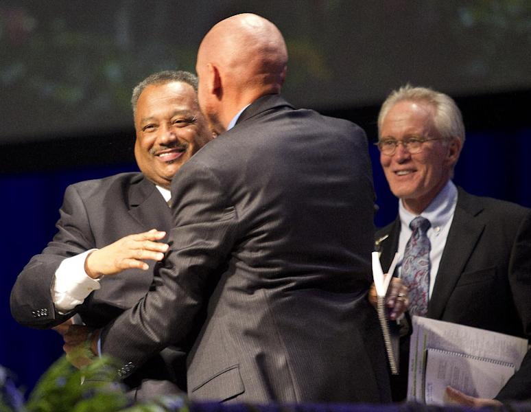 Rev. Fred Luter Jr. is congratulated after being re-elected as the Southern Baptist Convention's president during the 2013 Southern Baptist Convention Annual Meeting at the George R. Brown Convention Center Tuesday, June 11, 2013, in Houston. Luter is the SBC's first black president. (AP Photo/Houston Chronicle, Johnny Hanson)