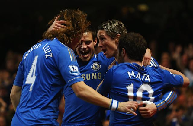 LONDON, ENGLAND - DECEMBER 23: Fernando Torres of Chelsea (2R) celebrates with team mates as he scores their first goal during the Barclays Premier League match between Chelsea and Aston Villa at Stamford Bridge on December 23, 2012 in London, England. (Photo by Clive Rose/Getty Images)