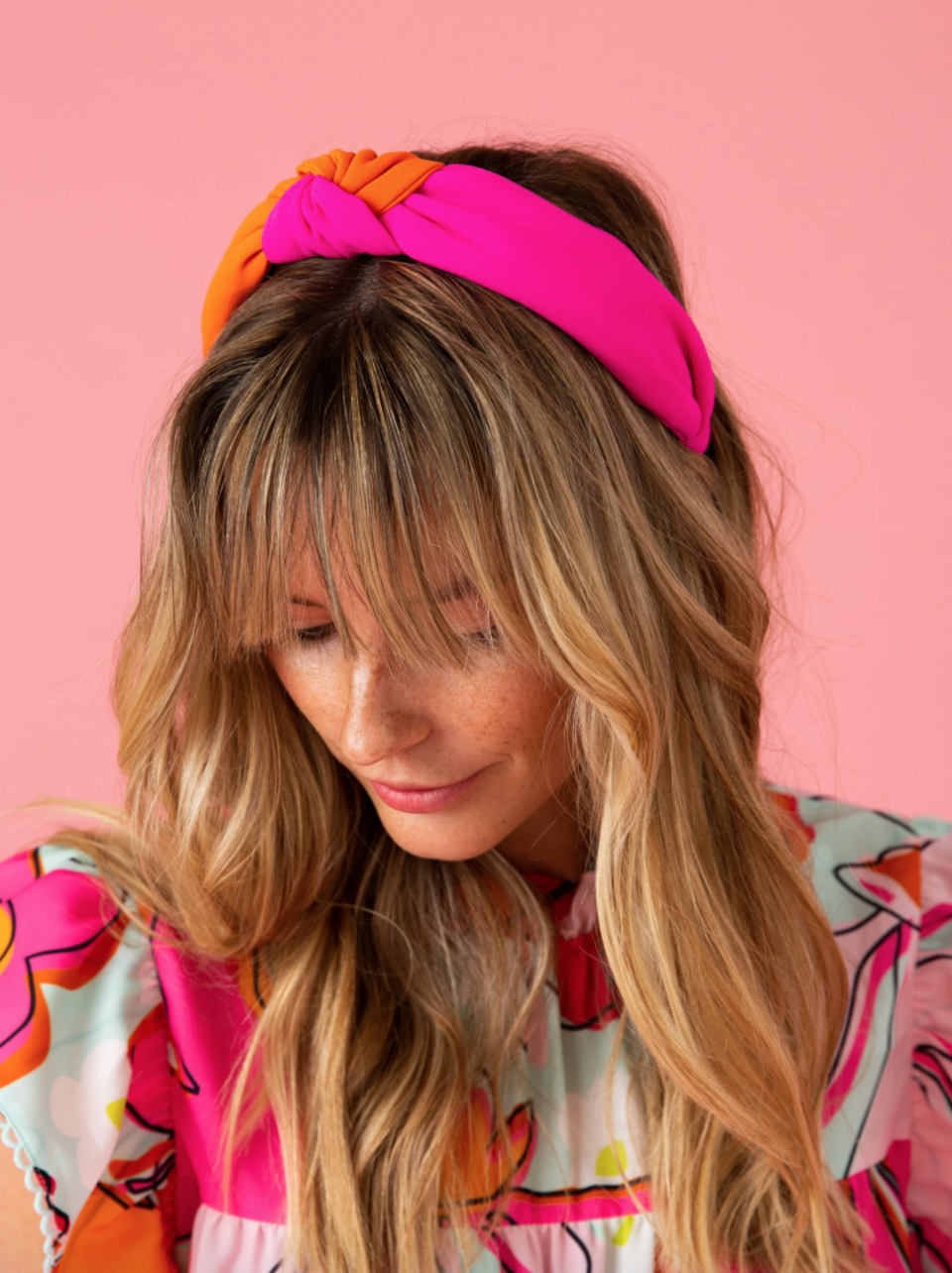 """<p><strong>CROSBY by Mollie Burch</strong></p><p>crosbybymollieburch.com</p><p><strong>$38.00</strong></p><p><a href=""""https://www.crosbybymollieburch.com/collections/headbands/products/holly-headband"""" rel=""""nofollow noopener"""" target=""""_blank"""" data-ylk=""""slk:Shop Now"""" class=""""link rapid-noclick-resp"""">Shop Now</a></p><p>The beautiful color combination of bright pink and orange will really pop against your hair. </p>"""