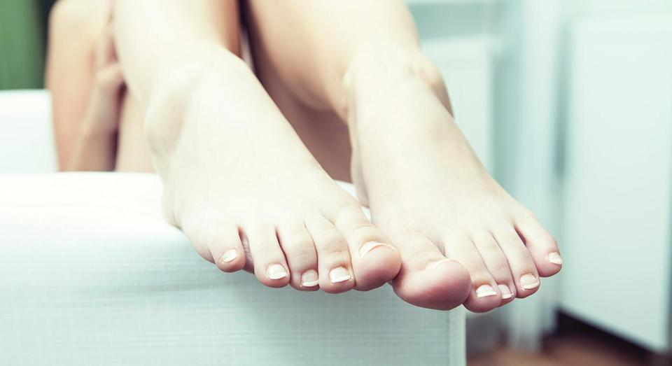 The Subway employee rested her feet on the food preparation counter. [Photo: Unsplash]