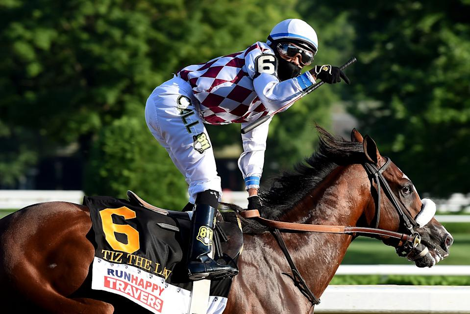 Manny Franco reacts after crossing the finish line with Tiz the Law to win the Travers Stakes.