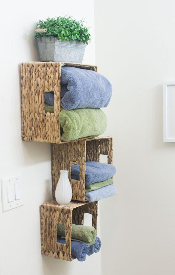 "<p>Don't actually have a linen closet in your bathroom? No problem. Attach baskets to the wall for a spot to fold extra towels and washcloths</p><p>Get the tutorial at <a rel=""nofollow"" href=""https://myweeabode.com/affordable-storage-solutions-for-small-bathrooms/"">My Wee Abode</a>.</p>"