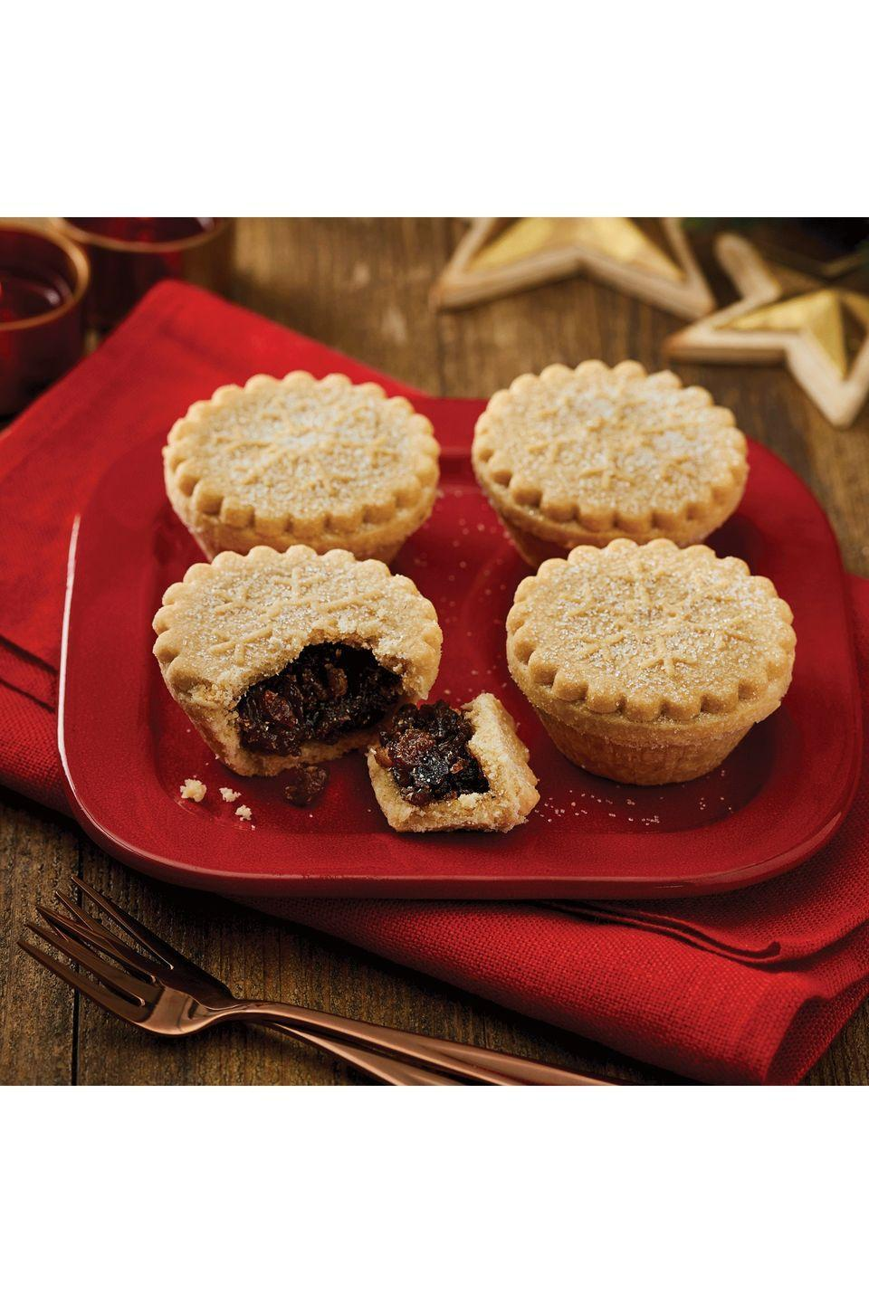 "<p><strong>Overall score: 59/100</strong></p><p>These gluten-free mince pies give a sweet and zesty aroma from the lemon and orange peel within the fruity mincemeat. The traditional snowflake design offers a good ratio of pastry to filling, but the gritty pastry has an artificially sweet flavour. </p><p><strong><a class=""link rapid-noclick-resp"" href=""https://go.redirectingat.com?id=127X1599956&url=https%3A%2F%2Fgroceries.morrisons.com%2Fproducts%2Fmorrisons-free-from-mince-pies-4pk-385245011%3FsortBy%3DmostRecent&sref=https%3A%2F%2Fwww.goodhousekeeping.com%2Fuk%2Ffood%2Ffood-reviews%2Fg23783723%2Fbuy-the-best-gluten-free-mince-pies-this-christmas%2F"" rel=""nofollow noopener"" target=""_blank"" data-ylk=""slk:BUY NOW"">BUY NOW</a> Morrisons, £2 for 4 (serves 4)</strong></p>"