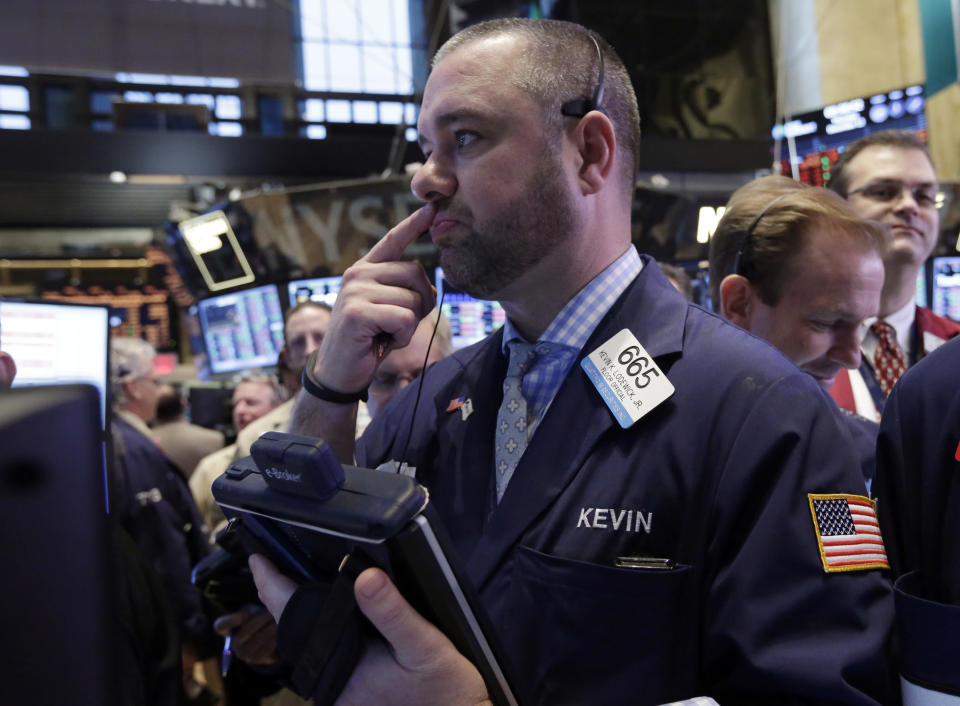 Trader Kevin Lodewick works on the floor of the New York Stock Exchange, Thursday, Dec. 12, 2013. Lower U.S. stock prices on Thursday set up investors for what would be their third day in a row of declines. (AP Photo/Richard Drew)