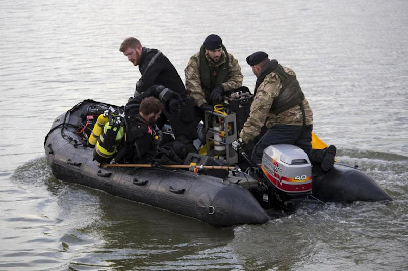 Royal Navy bomb disposal divers in King V George Dock close to London City Airport (PA)