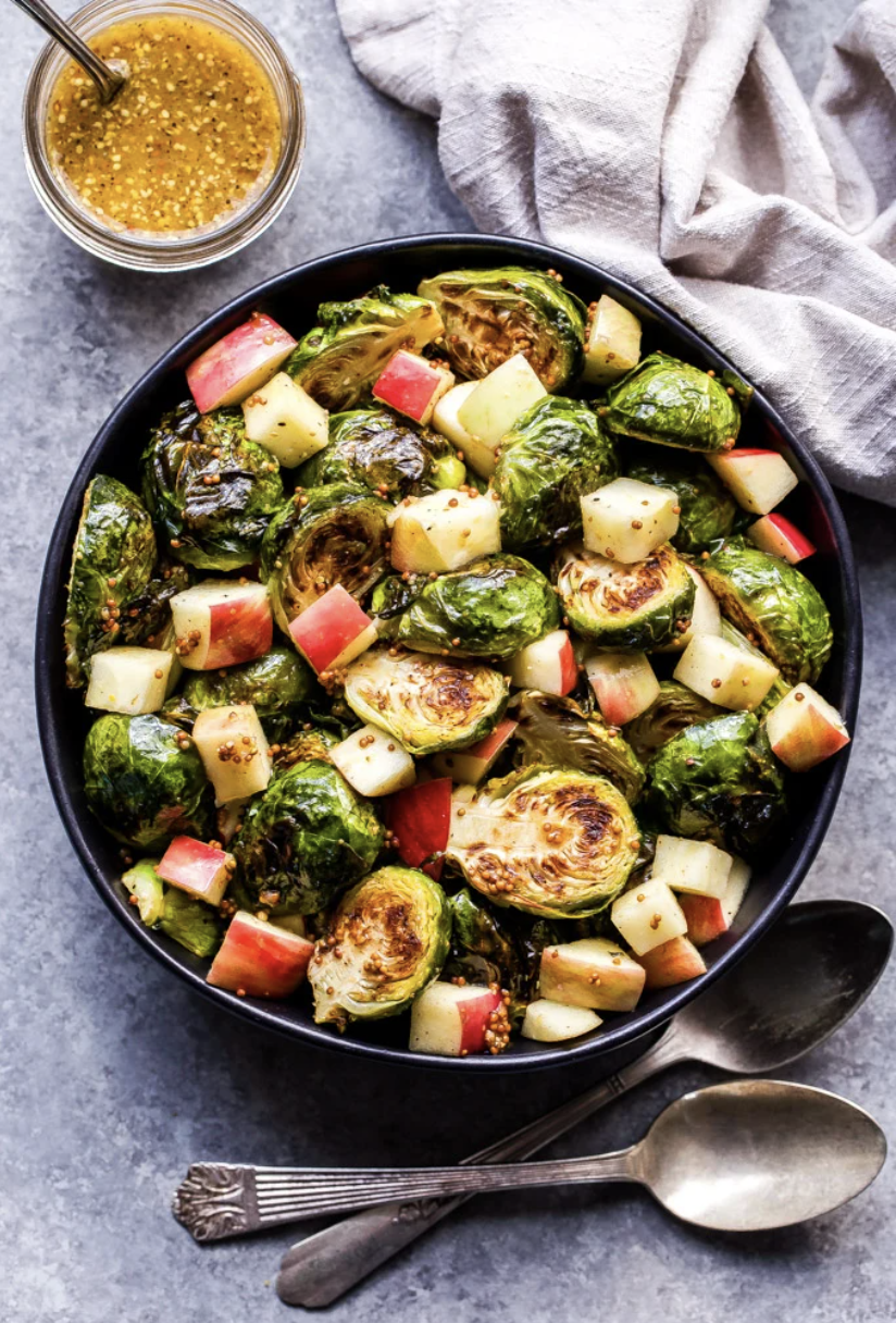 """<p>Give us all the fall flavors! Diced apples and a tangy-sweet maple dressing make this dish a stunning seasonal side. </p><p><strong>Get the recipe from <a href=""""https://reciperunner.com/roasted-brussels-sprouts-apples-maple-mustard-dressing/"""" rel=""""nofollow noopener"""" target=""""_blank"""" data-ylk=""""slk:Recipe Runner"""" class=""""link rapid-noclick-resp"""">Recipe Runner</a>.</strong></p>"""