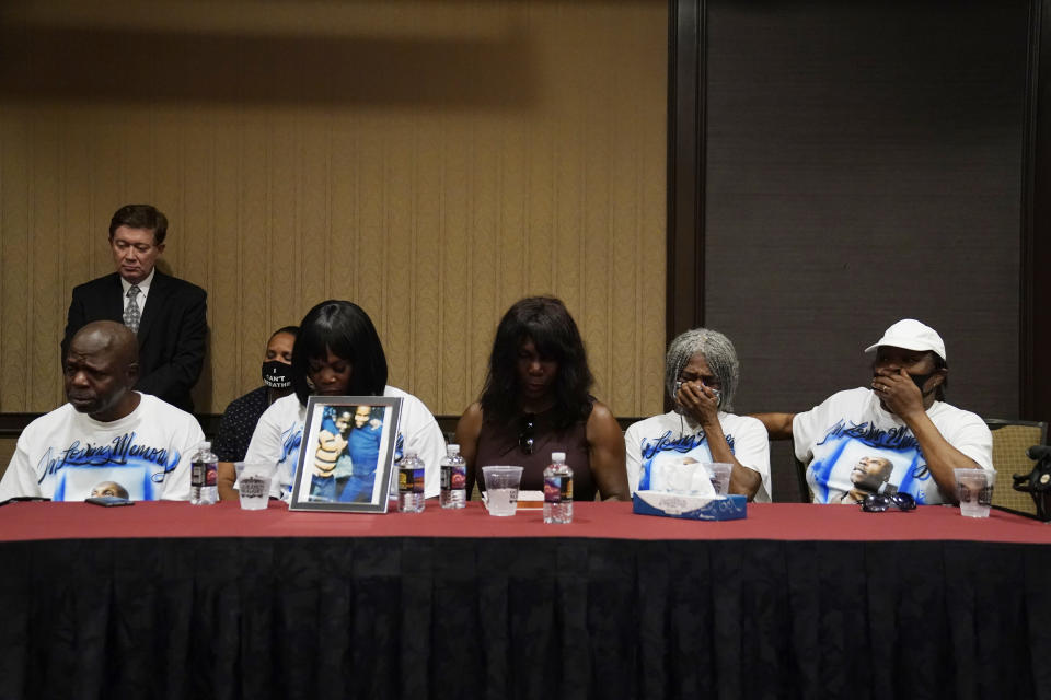 Siblings of Byron Williams, from left, Ellis Magee, Robyn Williams, Tina Lewis-Stevenson, Cheryl Lewis and Gwendolyn Lewis listen during a news conference Thursday, July 15, 2021, in Las Vegas. The family of 50-year-old Byron Williams whose death in Las Vegas police custody after a bicycle chase in 2019 was ruled a homicide is suing the city and four officers they accuse of wrongful death and civil rights violations. (AP Photo/John Locher)