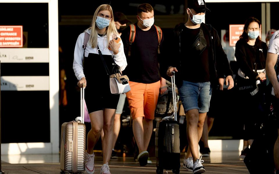 Russian tourists arriving in Antalya, Turkey today - Anadolu Agency via Getty Images