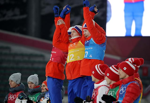 Ski Jumping - Pyeongchang 2018 Winter Olympics - Men's Team Final - Alpensia Ski Jumping Centre - Pyeongchang, South Korea - February 19, 2018 - Gold medalists Daniel Andre Tande, Andreas Stjernen, Johann Andre Forfang and Robert Johansson of Norway celebrate during the victory ceremony. REUTERS/Carlos Barria