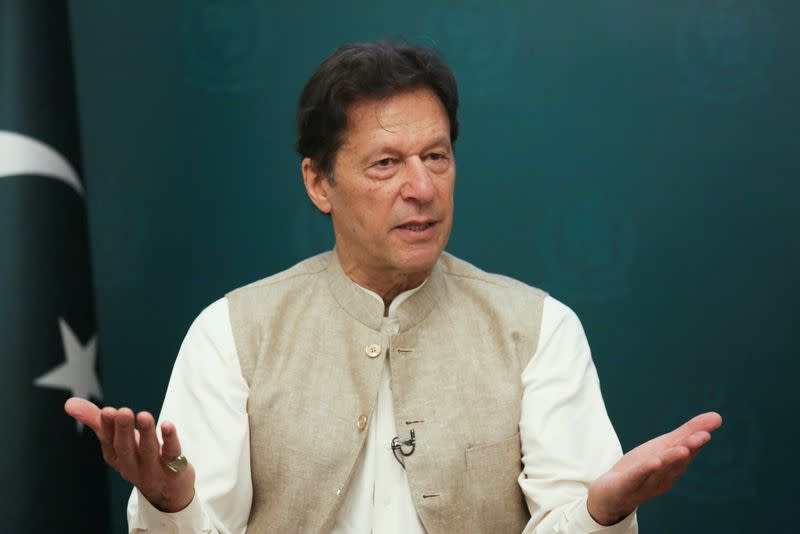 Pakistan's Prime Minister Imran Khan gestures during an interview with Reuters, in Islamabad