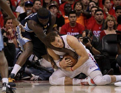 Blake Griffin (R) of the Los Angeles Clippers fights for a loose ball with Zach Randolph of the Memphis Grizzlies in Game Three of the Western Conference Quarterfinals in the 2012 NBA Playoffs, on May 5, at Staples Center in Los Angeles, California. The Clippers won the game 87-86 and lead the series 2-1