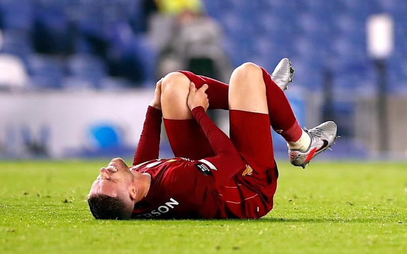 Jordan Henderson reacts after picking up an injury before going off during the Premier League match at the AMEX Stadium, Brighton -Liverpool captain Jordan Henderson to be assessed on Merseyside after injury scare in Brighton win - PA