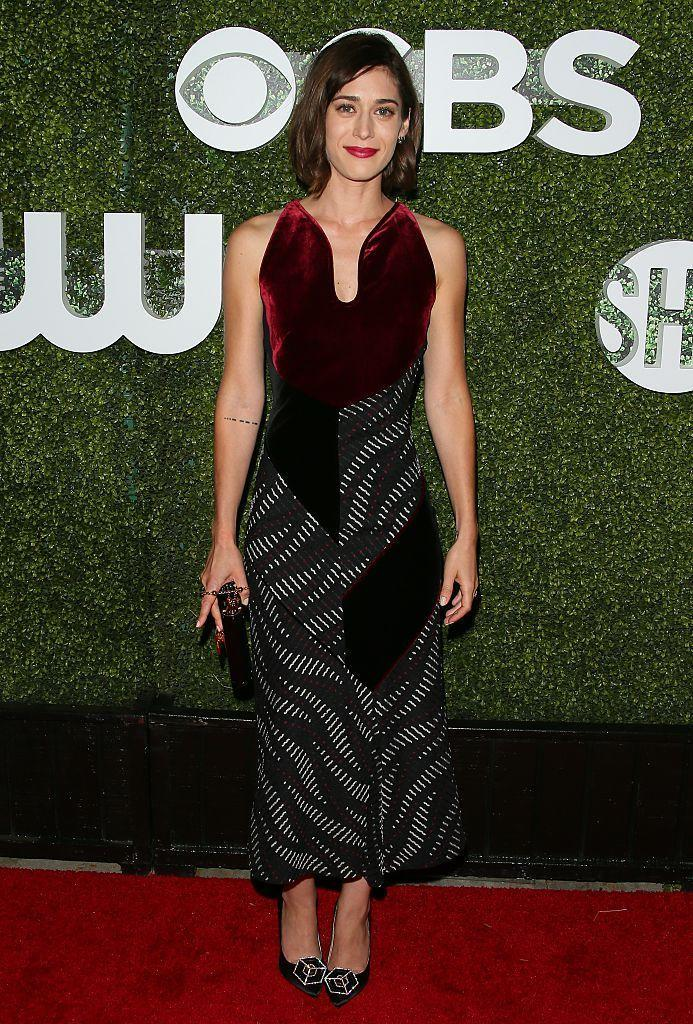 <p>A deep burgundy swath of velvet adds an extra dose of elegance to this patterned Rouland Mouret dress. <i>(Photo by JB Lacroix/WireImage)</i></p>