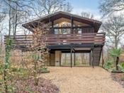 """<p><strong>Sleeps:</strong> 2 + 1 dog</p><p>This striking stilt house set in a leafy and tranquil position beside the Beaulieu River is a modern kind of treehouse with impeccable interiors. It's set in the New Forest National Park, with miles of open forest to explore right on the doorstep. Inside, you'll find a cosy lounge, a contemporary bathroom and wonderful spaces to dine. It's the perfect treehouse stay for couples looking to get away from it all in Hampshire.</p><p>Treehouse holidays cost from £519 for three nights from holidaycottages.co.uk. £20 supplement for dog</p><p><a class=""""link rapid-noclick-resp"""" href=""""https://go.redirectingat.com?id=127X1599956&url=https%3A%2F%2Fwww.holidaycottages.co.uk%2Fcottage%2F78005-crows-nest-cabin&sref=https%3A%2F%2Fwww.housebeautiful.com%2Fuk%2Flifestyle%2Fproperty%2Fg33931209%2Ftreehouse-holidays%2F"""" rel=""""nofollow noopener"""" target=""""_blank"""" data-ylk=""""slk:SEE INSIDE"""">SEE INSIDE</a></p><p><strong>Like this article? <a href=""""https://hearst.emsecure.net/optiext/cr.aspx?ID=DR9UY9ko5HvLAHeexA2ngSL3t49WvQXSjQZAAXe9gg0Rhtz8pxOWix3TXd_WRbE3fnbQEBkC%2BEWZDx"""" rel=""""nofollow noopener"""" target=""""_blank"""" data-ylk=""""slk:Sign up to our newsletter"""" class=""""link rapid-noclick-resp"""">Sign up to our newsletter</a> to get more articles like this delivered straight to your inbox.</strong></p><p><a class=""""link rapid-noclick-resp"""" href=""""https://hearst.emsecure.net/optiext/cr.aspx?ID=DR9UY9ko5HvLAHeexA2ngSL3t49WvQXSjQZAAXe9gg0Rhtz8pxOWix3TXd_WRbE3fnbQEBkC%2BEWZDx"""" rel=""""nofollow noopener"""" target=""""_blank"""" data-ylk=""""slk:SIGN UP"""">SIGN UP</a></p>"""