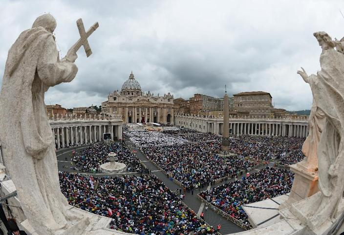 Huge crowds gather for the canonisation mass of Popes John XXIII and John Paul II on St Peter's Square at the Vatican in 2014 (AFP Photo/Vincenzo Pinto)