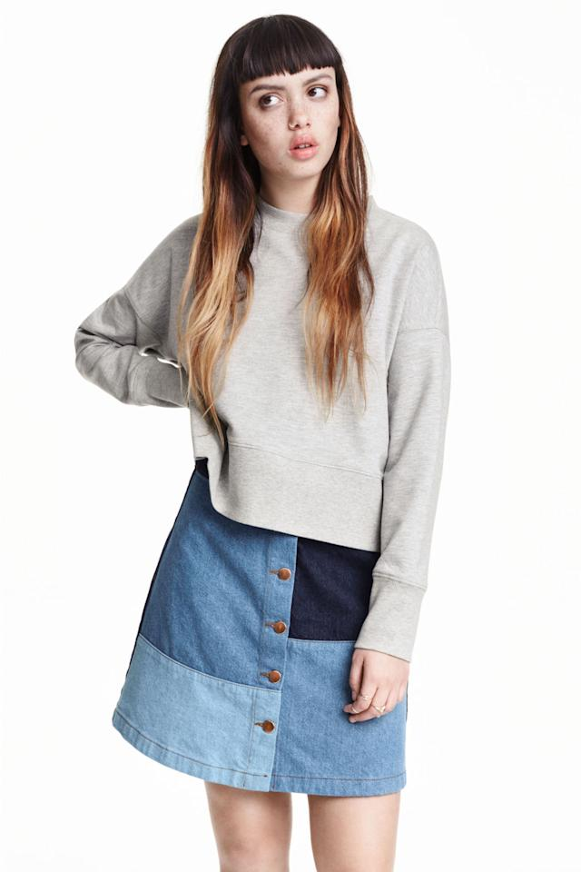 """<p>There is nothing basic about this patchwork denim skirt. Style with a chic jumper and over the knee boots for a raving retro outfit.<a href=""""http://www2.hm.com/en_gb/productpage.0376440001.html#""""><i>[H&M, £24.99]</i></a><br /><br /></p>"""