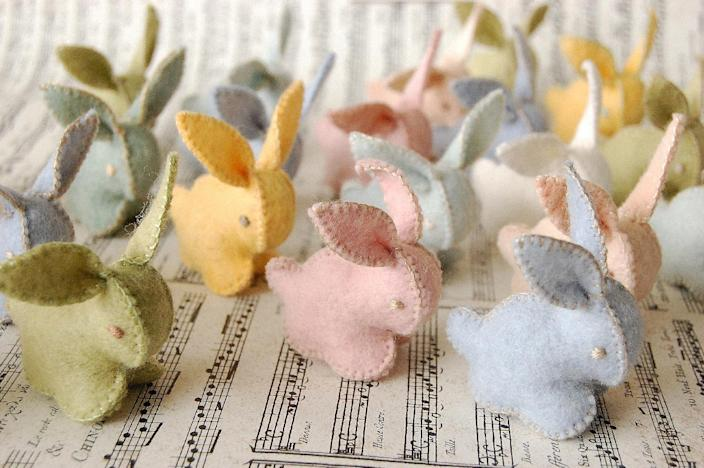 """This undated publicity photo provided by Textile Platypus shows Canadian textile artist Cristina Larsen crafts winsome stuffed felted bunnies and chicks in a rainbow of hues. She uses merino wool to make all the felt, dyes the colors and stitches every toy by hand. While Larsen calls them """"toys,"""" they'd be equally at home as artsy Easter décor (www.etsy.com/shop/textileplatypus). (AP Photo/Textile Platypus, Cristina Larsen)"""